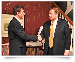 Photo of Robert Stripling and client shaking hands